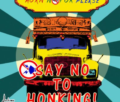 "Picture of a truck with ""No Honking"" sign."