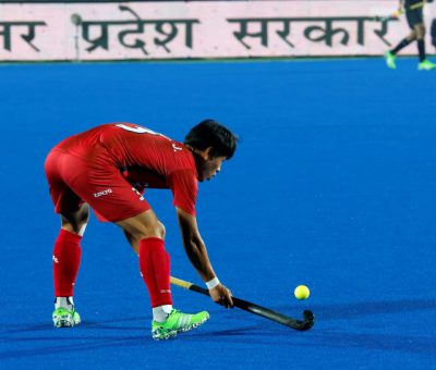 A hockey player about to hit the ball in Junior Men's Hockey world cup match at Lucknow, India