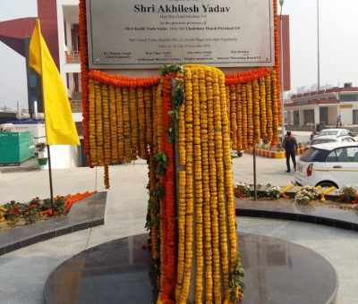 Pic of Foundation stone saying- Kisan bazar inaugurated by chief minister Shri Akhilesh Yadav