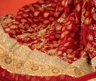 Picture of a maroon and golden lehnga