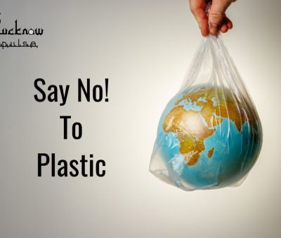 A globe in a plastic carrybag. Text caption: Say No to Plastic. LucknowPulse